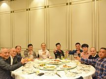 Wang Always Poses with Friends at Huahong Company's Annual Meeting